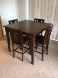 Square kitchen table with 4 chairs.