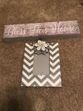 Small grey sign and picture frame.