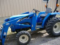 New Holland 4x4 tractor, loader,mowerTrailer