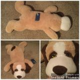 BIG oversized plush dog in GUC. $7.00, phone shows size, this Is BIG.