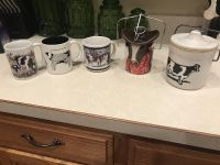 Cow mugs and cheese containers..All for $12