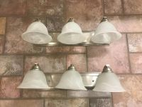 Silver and white vanity lights