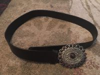Belt with large buckle - ppu (near old chemstrand & 29) or PU @ the Marcus Pointe Thrift Store (on W st)