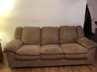 Tan sofa with pullout bed