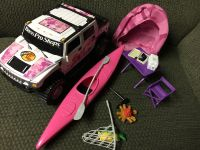 Bass Pro pink hummer with canoe, tent, accessories