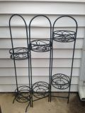 """Cute metal plant holder - 34"""" tall, 23"""" wide. Holds 6 plants. Dark green color *Porch Pickup*"""
