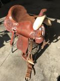 Circle Y Roping Saddle-16 1/2 -EUC-hand tooled, blanket and stand included.