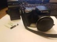 Canon PowerShot SX400 IS Digital Camera with Charger FREE