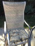 Two sling back swivel and rocking patio chairs