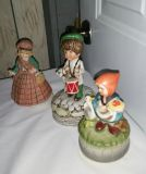 Music boxes. Boy on drum 8 in tall, made in Korea, girl 7 in tall item 3151. Girl and duck 6.5 in tall made in Japan. All work. All for $10