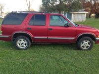 1999 CHEVY BLAZER 4X4 ( POOR BODY BUT DEPENDABLE)