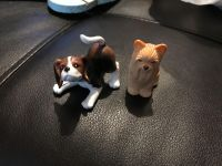 2 small puppie toys