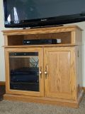 """TV/audio stand. Little scuffed up but very sturdy. Dimensions are 20""""deep by 34"""" wide by 32"""" tall. Opening on top is 4 1/2 """" tall."""