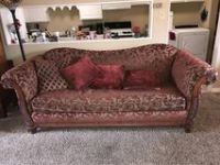Red and Gold Love seat and big couch with lots of pillows