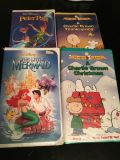 VHS Disney and Charlie Brown tapes.