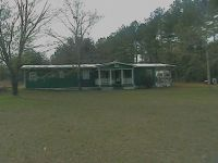 8 1/2 acres with dwellings and 2 ponds