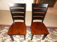 pair of laddar back black and cherry dining room chairs