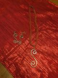 Sterling silver scroll pendent and matching earrings on leather necklace