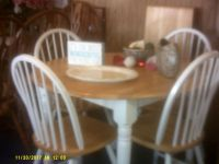 round table with leaf and four chairs