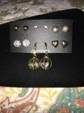 Brand new Gold tone earring studs and 1 dangle earrings set. Comes w/clear rhinestones and crystals in some earrings. Super pretty