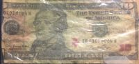 $10 Bill with Red Ink