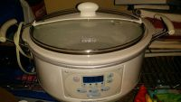 Barely used slow cooker,used nostalgic popcorn popper,and a used snow cone maker