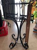 Over foot tall metal stand. Can add chandelier drops, fill w/plant or other