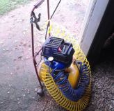 like new 6 gallon air compressor with accessories on a dolly