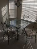 Iron & Glass table w/4 chairs. EUC. $45 Cordova pick up for all