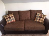 Brown Faux Leather and upholstered sofa