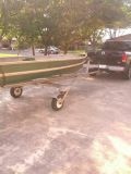 fiberglass boat with trolking motor and trailer