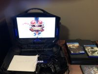 PS4 Pro w/portable TV game station, 4 games included