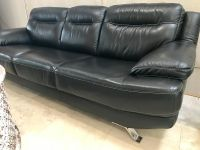 Less then 2 yr old black leather sofa
