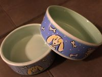 Two small dog bowls