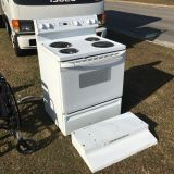 GE true temp electric stove/oven and hood - Marcus Pointe Thrift Store