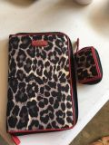 Authentic Coach tablet case and contact lens case