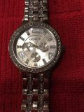 Women's Geneva silver watch with crystal accents on dial and band