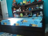 Twin bed with shelves