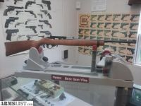 For Sale: New RUGER 10/22 rifle carbine model with wood stock