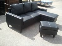new in box black bonded leather mini sectional with ottoman