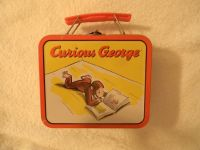 """curious george """"reading"""" mini metal lunch box. around the edges curious george"""