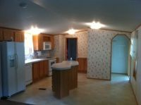 3 Bedroom 2 Bath with a large sunroom and storage building