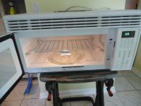 Whirlpool Convection Microwave Oven over the stove
