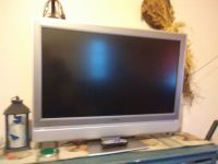 Toshiba 37in flat-screen  TV gray on swivel stand