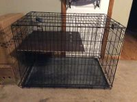 Xlarge dog crate has a divider to make the cage smaller for training. We used it as a second layer for our cat.