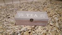Wood Tea Box in Grey and White with Wood Bottom. Has 3 Divided Slots to Keep Tea Bags Organized and Fresh. Has Clasp to Keep it Sealed.