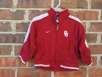 2t OU NIKE zipup jacket with front pockets. OKLAHOMA on back .