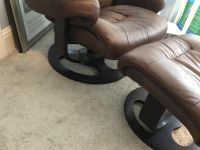 Brown leather recliner with ottoman
