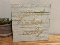Good vibes only faux wood sign. 24 hour pu behind Alamo Drafthouse