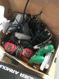 Lot of Nintendo systems with cords, controllers and some games.